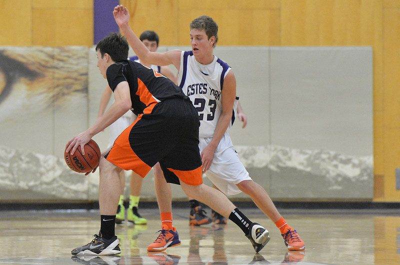 Isaak Cirone defends against the Sterling Tigers on Saturday. The Bobcats came close but could not take down the Tigers, losing 49-43.
