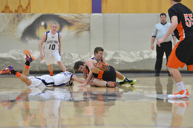 Chris Moody and Andrew Cirone attempt to wrestle a loose ball away from a Sterling player on Saturday. While the Bobcats clawed back into their game with the Tigers, it was not enough as the Estes Park boys lost 49-43.