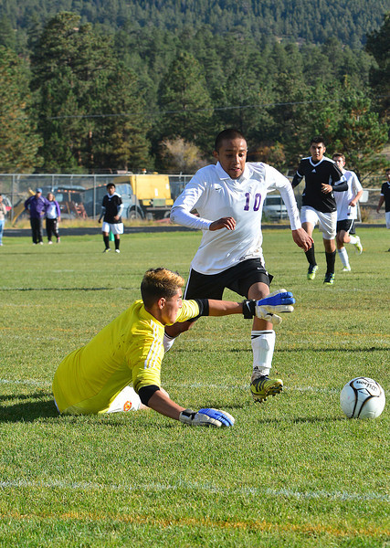 Walt Hester | Trail-Gazette<br /> Erick Dominguez draws out Valley keeper Harry Hernandez in the first half of the Thursday match. Hernandez drew a red card and was ejected after tripping Dominguez, all of which resulted in an Estes Park goal from a penalty kick.