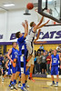 Andrew Cirone tries to out leap Max Clark in the third quarter of the Bobcats' Thursday match up against Peak to Peak. The Pumas team height seemed to counter the Estes Park jumpers.