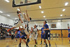 Andrew Cirone and Zach Pierce leap for a rebound late in the first half against Peak to Peak on Thursday. The Bobcats had a rough time against the tall Puma team, losing by six.