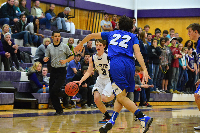 Zach Pierce drives up the floor agains Peak to Peak on Thursday. The Pumas' height advantage may have been the difference as they handed the Bobcats only their second loss of the season.