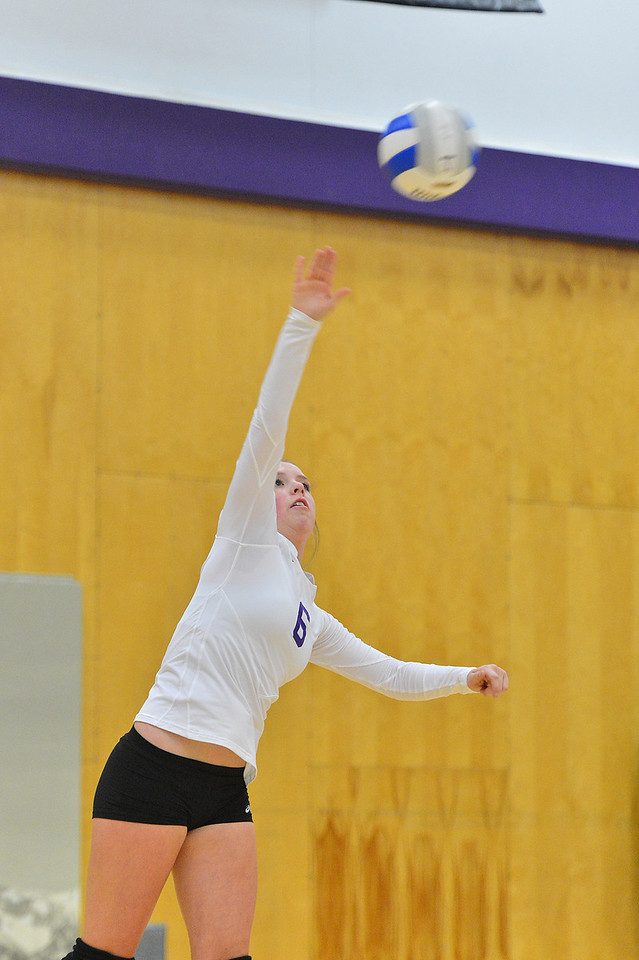 Becky Reilly serves earlier this season. Reilly has 28 kills and four ace serves this season.