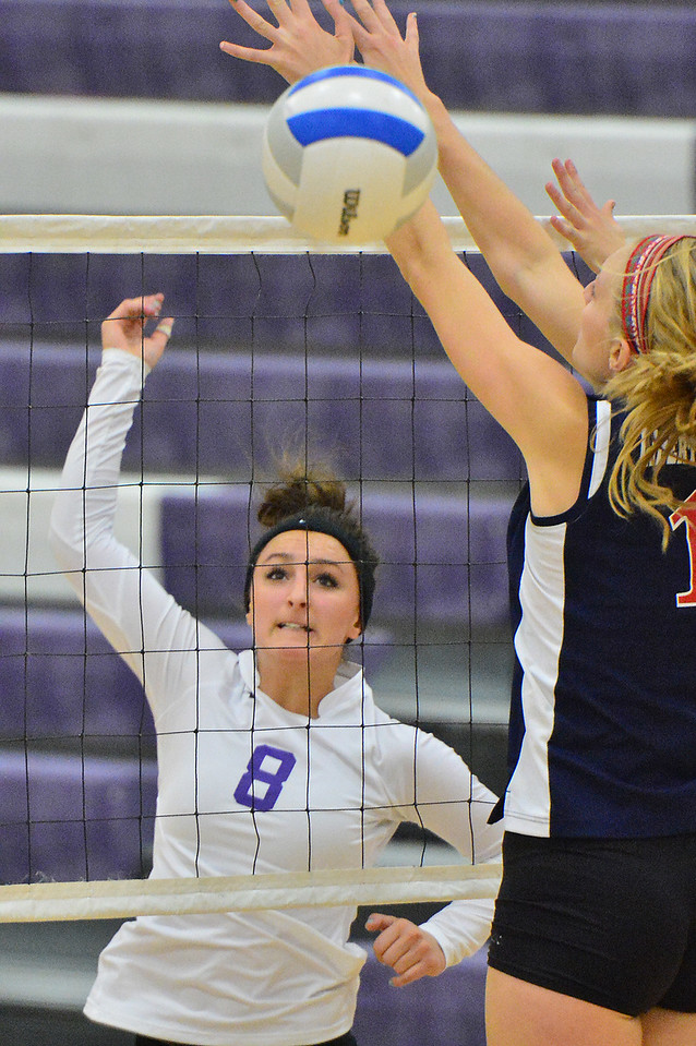Walt Hester | Trail-Gazette<br /> Maya Michener earns a kill against Liberty Common earlier this season. The girls have had a rough stretch in the last several games and will need a good effort to get back on track.