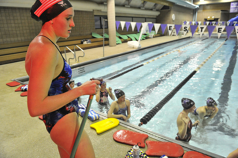 """Kate Hewson directs a cool spray at her team mates during Monday night's workout. Hewson described her team as """"Swimming tired"""" at the weekend's Colorado Coaches Invitational."""