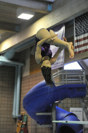 Annabelle Westley flips during a dive on Tuesday. The divers, who scored second and third, were improtant in helping the Ladycats beat Skyline at their meet this week.