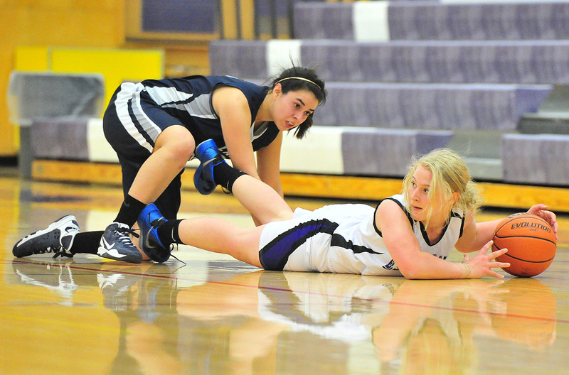 Estes Park's Susannah Jones sprawls on the floor while looking for an outlet for one of her 11 steals against the visiting Lady Timberwolves of The Pinnacle. Jones also led the team in assists with four.