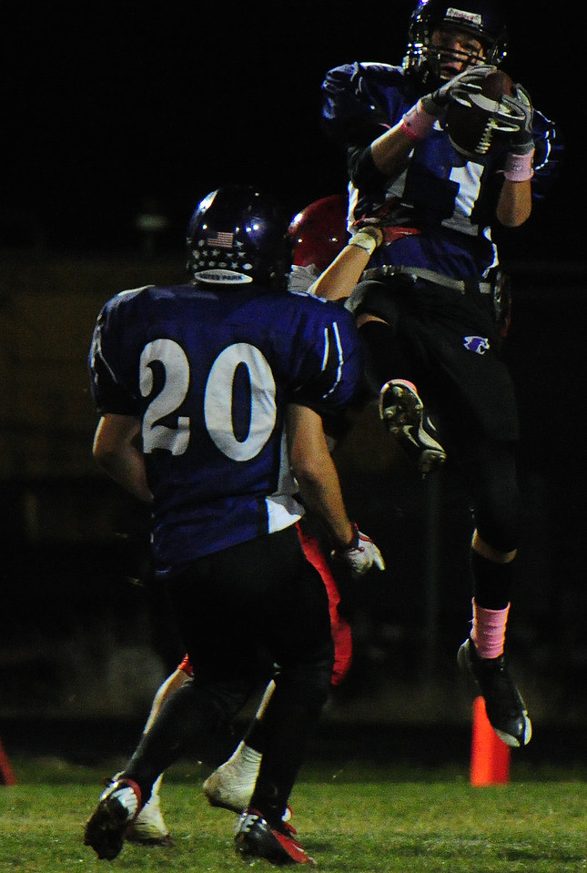 Isaak Cirone grabs an interception against the Jefferson Saints on Friday. Brothers Ben and Andrew also produced; Ben had an interception of his own and Andrew recovered an onside kick.