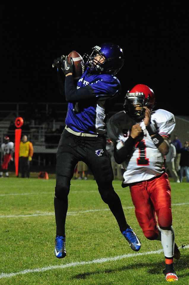 Adam Christianson grabs a pass against the Jefferson Saints on Friday. Christianson was separated from the ball by the Jefferson defender.