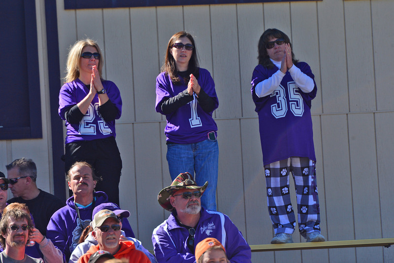 Football moms cheer for their kids during Saturday's game.