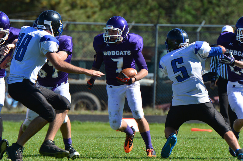 Adam Christenson looks for daylight against Platte Canyon on Saturday. The brilliant autumn sun was the only light the Bobcats got for most of the game, accumulating a mere 72 yards total rushing and dropping five fumbles against the visiting Huskies.