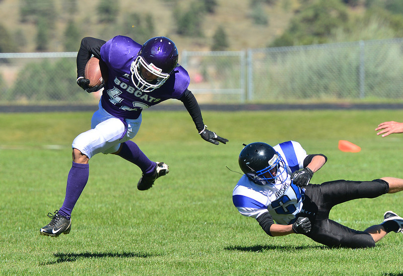 Senior Manish Shankar sheds a Husky tackler during a kick return on Saturday. Shankar has earned plenty of time on the field as he kicks, returns and defends for the Bobcats.
