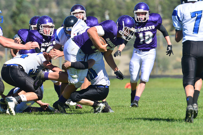 Quarterback Frankie KellerTwigg runs through arm tackles against the visiting Platte Canyon Huskies on Saturday. KellerTwigg ran for 29 yards and through for 14 more.