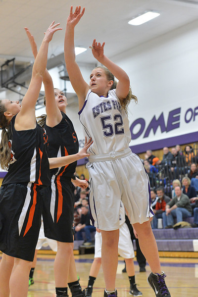 Sarah Kozlowski shoots against the Sterling Tigers on Saturday. The Ladycats could not overcome the big Sterling Lady Tigers, losing 42-29.