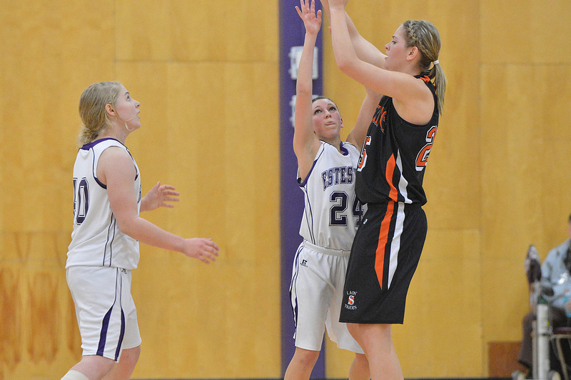 Estes Park defenders Susannah Jones, left, and Bizzy Palmer attempt to defend Sterling post player Tyler Chrisman. The Ladycats could not overcome the big Sterling Lady Tigers, losing 42-29.