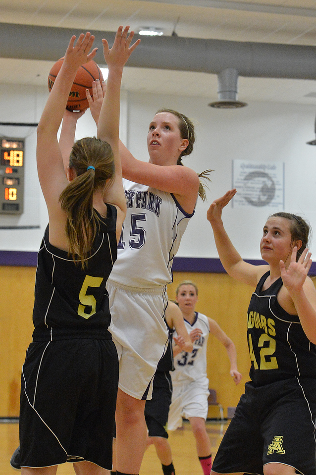 Becky Reilly shoots against the Jefferson Academy on Thursday. Reilly scored six points against the Jags and another eight against the Sterling Tigers on Saturday.