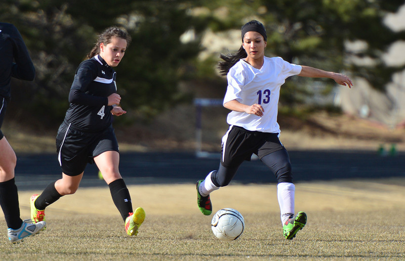 Senior midfielder Miranda Ruiz keeps the ball in the Viking half during Friday's game. After the weather-induced break, the girls were able to get back to winning, bettering the Vikings 2-1.