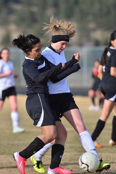 Jenna Wahler jostles for the ball against Valley on Friday. The sophomore is part of a young team featuring only four seniors on a team of 22 girls.