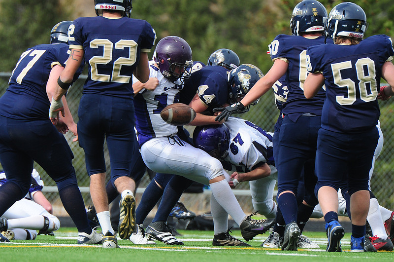 Frankie KellerTwigg (13) and Carlos Delgado (67) force another fumble against the Nederland Panthers on Saturday. The Bobcats forced several turnovers, two of which resulted in 'Cats' touchdowns.
