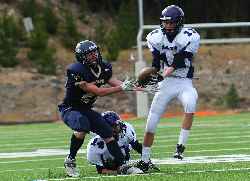 Estes Park defensive back Isaak Cirone takes an interception off of the fingertips of Nederland receiver Dillon Weaver in the second quarter of the Bobcats' game on Saturday. The Bobcats snatched four interceptions against the Panthers.