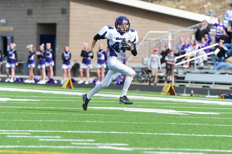 Ben Cirone dashes for the goalline after intrcepting a Nederland pass on Saturday. Ben now has one thing neither brothers Andrew or Isaak have; a touchdown.