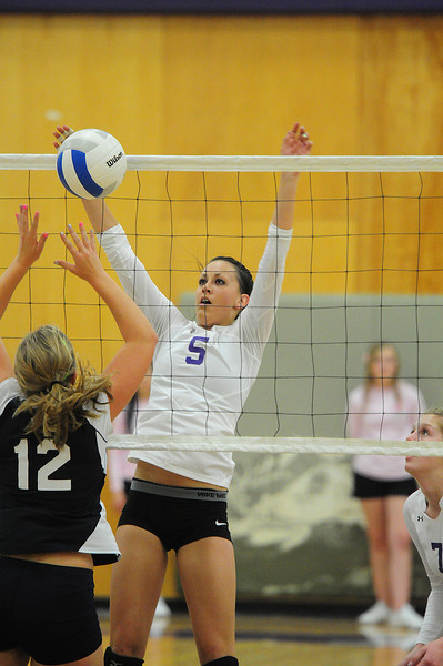 Erin Barker elevates for a block last fall. The senior lent her experience and leadership to a team that sufferd a tough season.