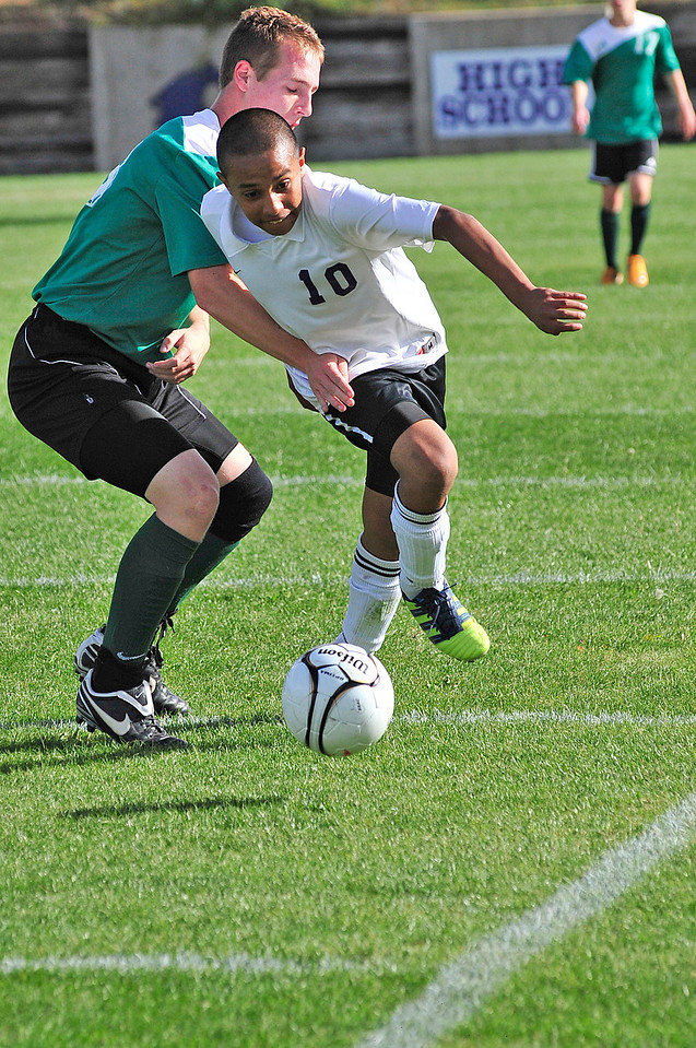Walt Hester | Trail-Gazette<br /> Erick Dominguez fights through the Heritage Christian defense in the first half of their Thursday match. While Dominguez tallied a goal against the Eagles, defenses seem to be looking for him and marking him early this season.