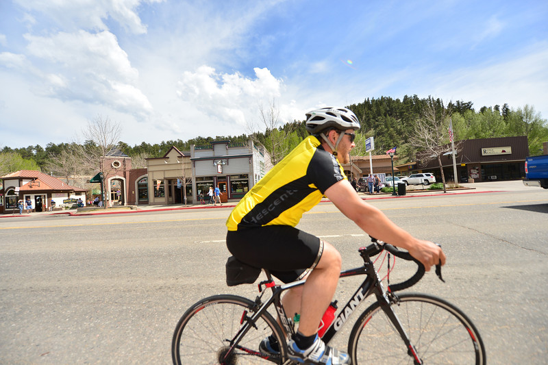 A cyclist cruises up Elkhorn Avenue on Saturday. Weather helped bring out visitors over the long Memorial Day weekend.