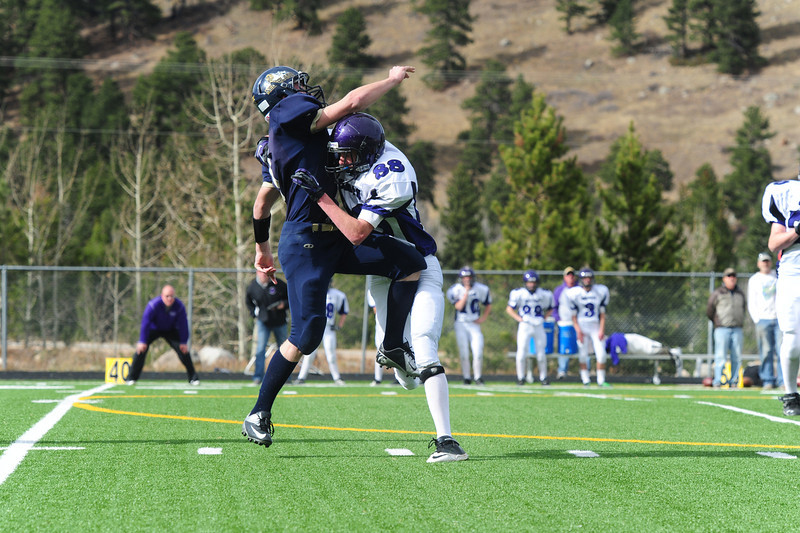 Spencer Woodard puts a hit on Nederland's quarterback last fall. Woodard is one of many younger players showing promise for the fututre of Bobcat football.