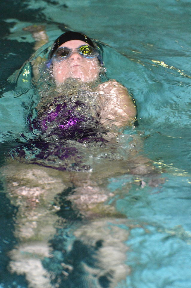 Madison Beesley serfaces after the third turn of the 100-yard backstroke against the Valley Vikings on Thursday, on the way to a close win in the race. The Ladycats beat the Vikings handily, 124 - 66.
