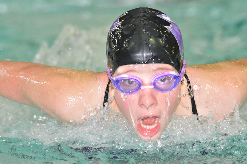 Holli Holmes swims the fly leg of the medley relay on Thursday. Holmes and the team touched ion 2:03.93, good for a slot at February's state swimming and diving meet.