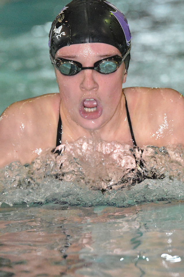 Kate Hewson swims the breaststroke leg of the individual relay on Thursday. Hewson and the Ladycats swim team easily beat the visiting Valley Vikings, 124-66, in the 'Cats last home meet of the season.