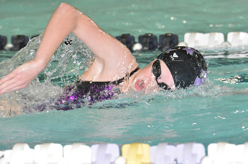 Kate Hewson strokes her way toward a first place in the 200 individual medley on Thursday. The Ladycats beat the Vikings handily, 124 - 66.