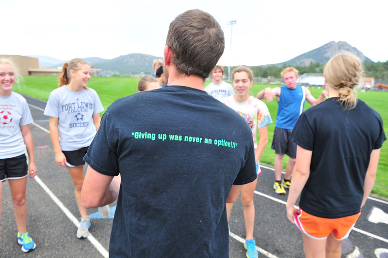 First-year head coach Nathaniel Mogle wears the team attitude before sending the team off on their time trial on Monday. Positive attitude is part of the team contract this season.