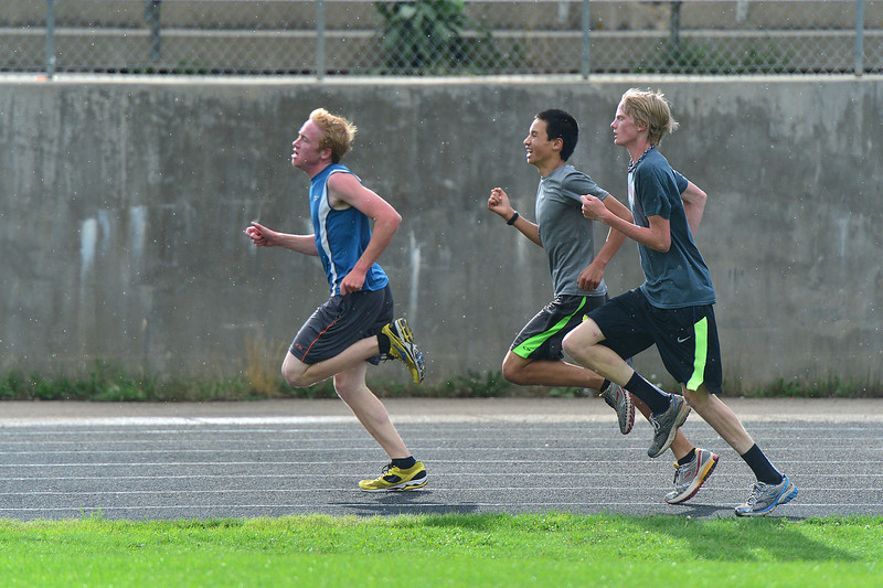 Younger runners sprint the final meters of the team's first-day time trial.