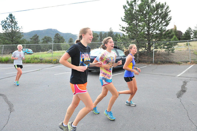 The Estes Park Cross Country girls cruise in after a warm up on Monday. The team enjoys not only a glut of returning leaders, but an unusually talented support team.