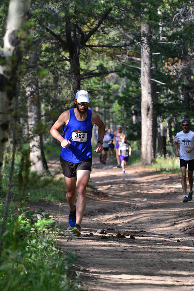Nathan Gray leads the small pack up the first climb of the Aspen Climb trail race on Sunday. Gary lead the race from start to finish.