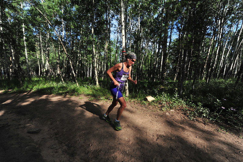 Beckie Greer plods up the first climb of Sunday's Aspen Climb trail run. The inaugural running of the race drew a small but dedicated group of runners to the Aspen Lodge trails.