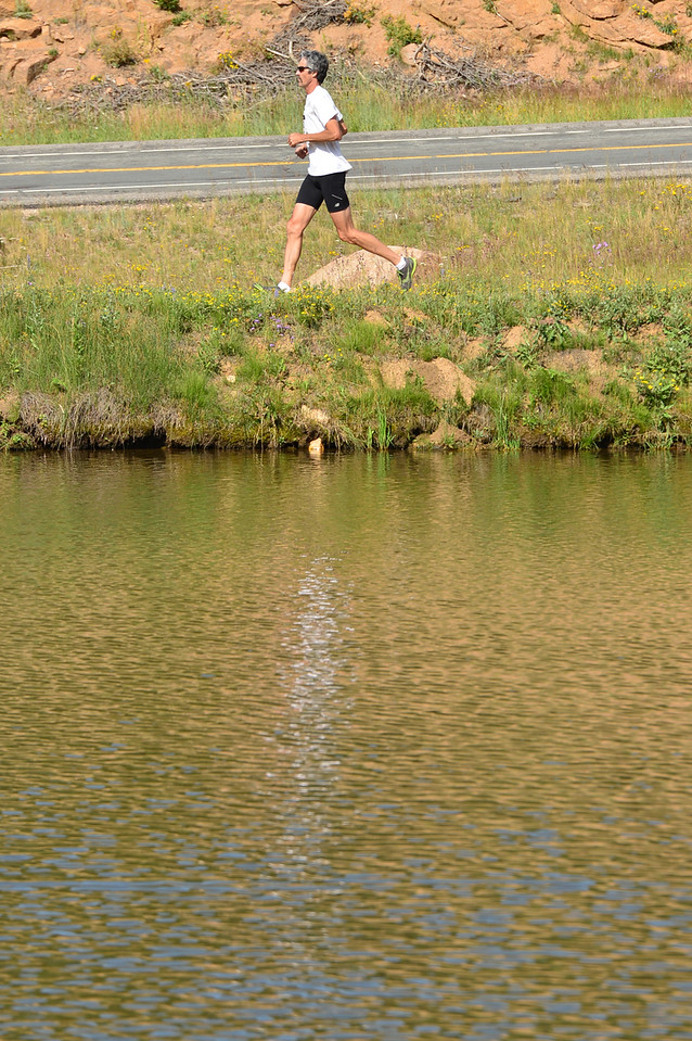 Steve Barker cruises across the bank of the Aspen Lodge's pond on Sunday. The lodge hosted the Aspen Climb trail run.