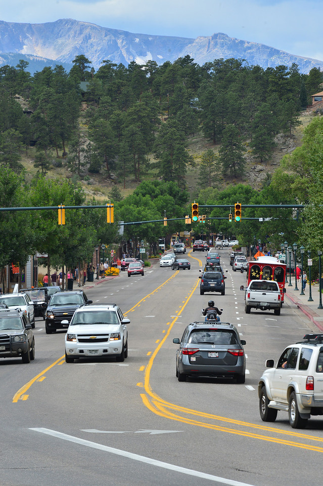 Traffic bussles through downtown Estes Park on Wednesday. The scene will be curb-to-curb cyclists on Saturday as the Pro Cycling Challenge contests the sixth stage's final intermediate sprint.