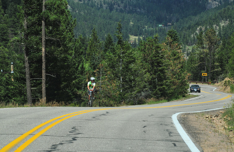 A rider grinds up the Glen Haven Switchbacks on Wednesday. While recreational riders suffer an eternity on the one-mile climb of 10 percent, the top brings the USA Pro Challeng's final King of the Mountains points on Saturday, provoking seemingly-superhuman efferts from pros.