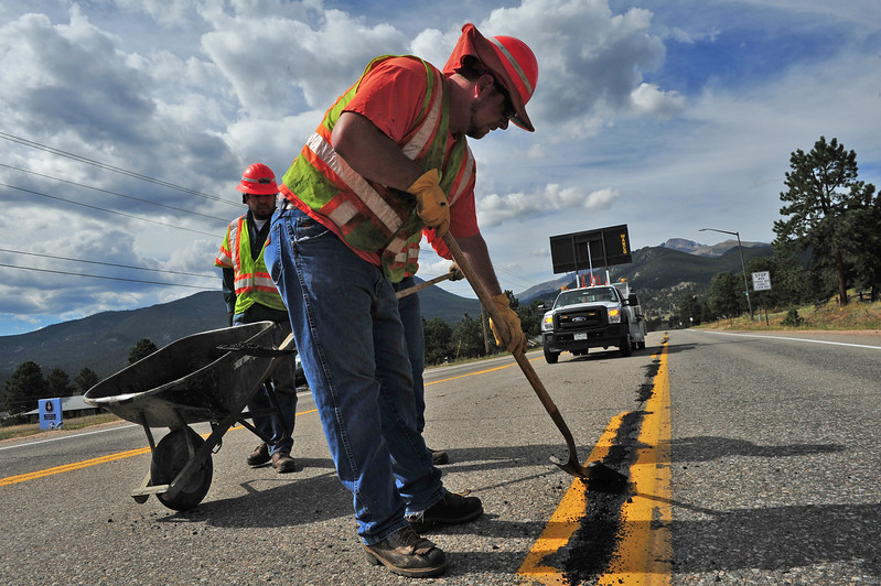 Crews from the Colorado Department of Transportation patch holes on St. Saiont Vrain Avenue on Wednesday. The road work was to smooth the road for drivers, and make it safer for the cyclists of the USA Pro Challenge who will race on the road on Saturday.
