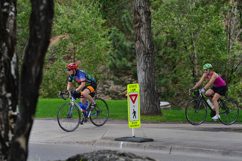 A pair of cyclists look to cross the far east end of Elkhorn Avenue on Wednesday. The intersection of Elkhorn, Big Thompson, Wonderview and St. Vrain avenues will be the only spot where fans can see the race pass by twice.