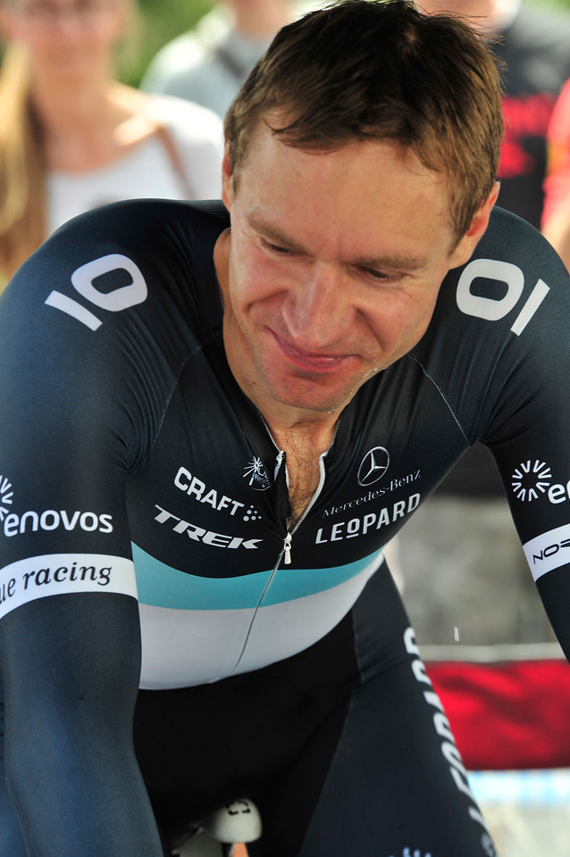Fan favorite Jens Voigt talks to fans while preparing to ride. The amiable German is a super-domestique, carrying water, chasing down breaks and protecting his team leader, but can still win races at 41.