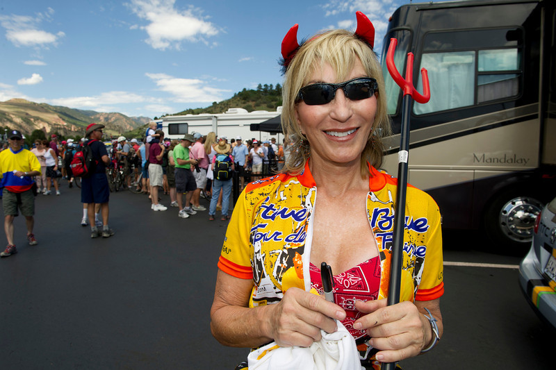 An exuberant cycling fan gathers autographs before the start of the fisrt USA Pro Challenge in 2011. Cyclists are extremely approachable, often spend 30 minutes signing autographs and talking woith fans.