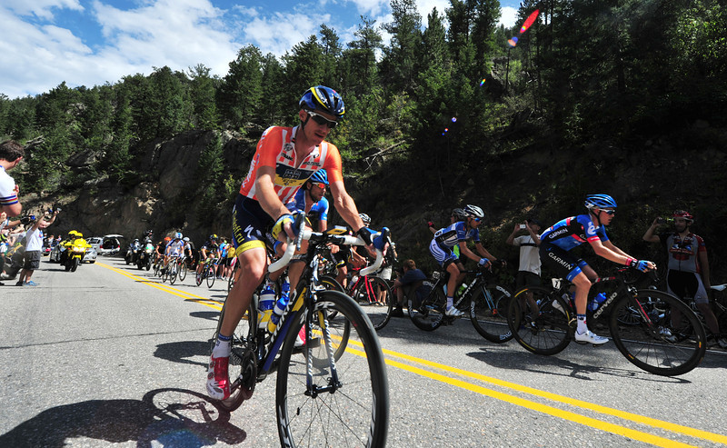 Mick Rogers of Saxo-Tinkoff leads the 15-man breakaway up the Glen Haven Switchbacks on Saturday. Rogers, wearing the orange and white FirstBank Most Aggressive Rider jersey, lead with the group until they were caught by the peloton near Horsetooth Reservoir.