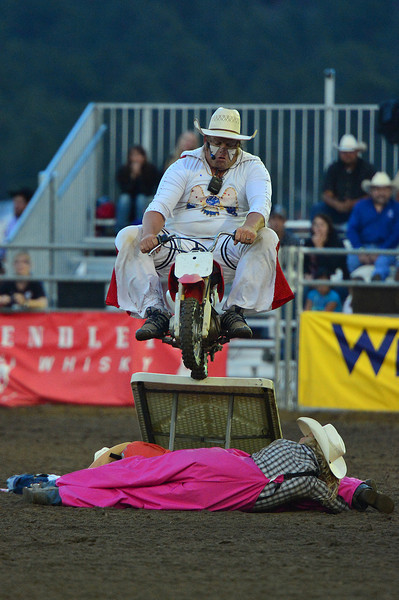 Rodeo Clown Justin Rumford jumps a tiny dirt bike over a pair of Riata Cowboy Girls on Saturday night. Rumford was last year's National Finals Rodeo alternate clown and barrelman.