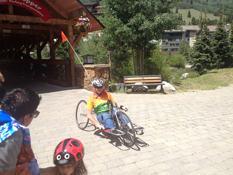 Members of Team Courage wheel into Copper Mountain Resort on Sunday. While some riders need special equipment, they all make it in.