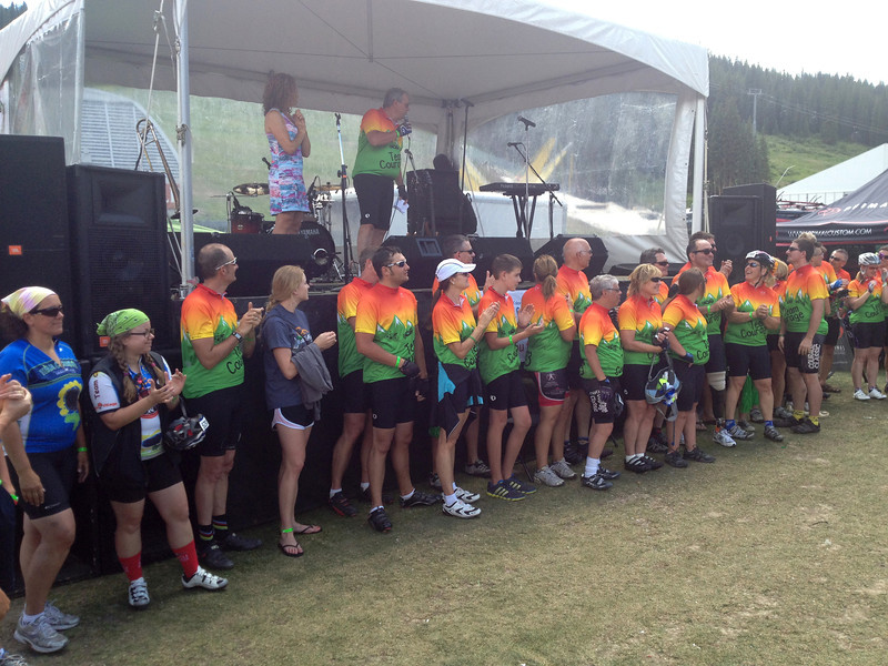 Team Courage, a cycling and fund-raising team of people who have benefitted from the work of Children's Hospital Colorado, are recognized Sunday evening after the day's ride.