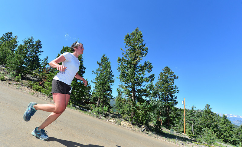 Kristi Ehle carefully descends the last mile of the Ascent Trail Run on Saturday. Ehle was the women's overall winner of the 5.9-mile race on Pole Hill, finishing in 54:38.